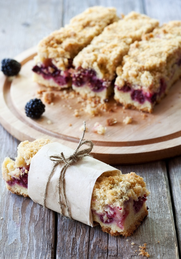 27058896_-_Wrapped_up_crispy_blackberry_bar_on_wooden_table.jpg