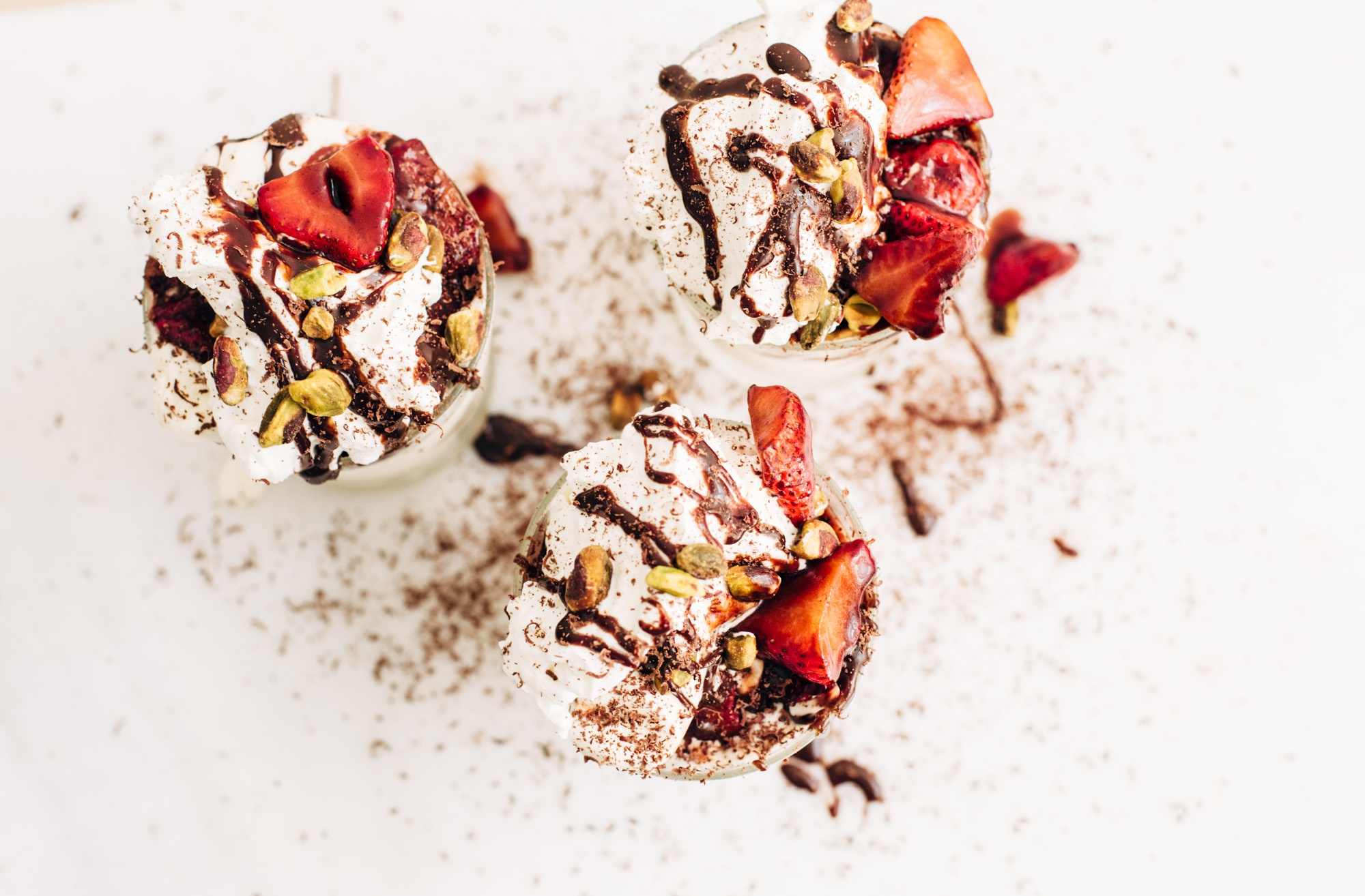 Balsamic Strawberry Sundae with Homemade Whipped Cream, Chocolate Sauce and Roasted Pistachios