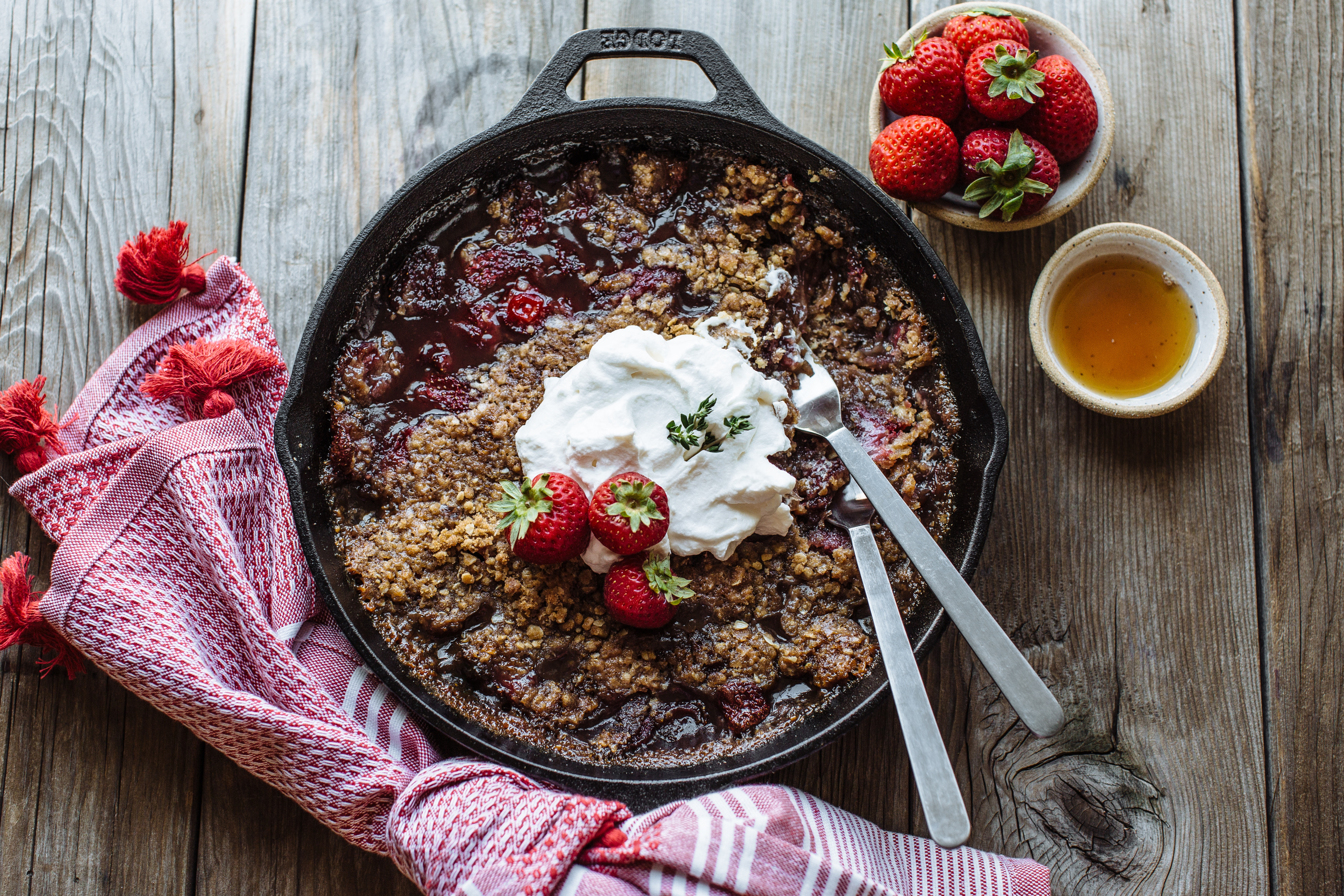 Strawberry and Oat Skillet Crisp with Maple Whipped Cream